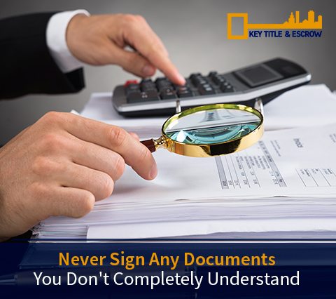 Picture of a Title Agent Checking Documents Before The Client Signs