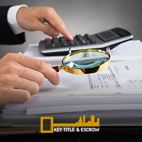 Picture of a Escrow Agent Checking a Property Document in Miami